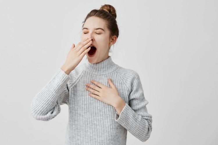 Woman Yawn Title