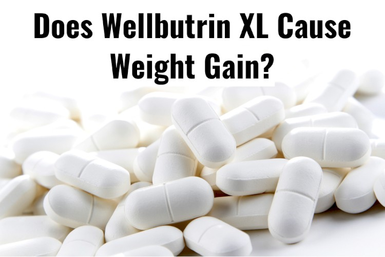 White Pills On Table With Text - Does Wellbutrin XL Cause Weight Gain?
