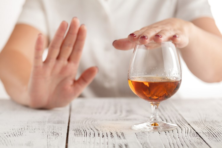 woman refuses to drink a alcohol - Image