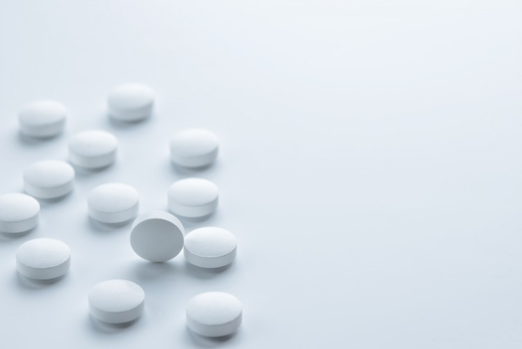 Medical,pharmacy theme background concept. White pills on white background