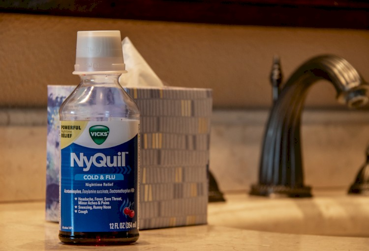 NyQuil bottle on bathroom counter